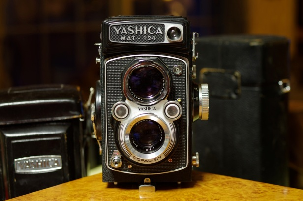 Yashica Mat 124, 1968-1970 With original case to the left.