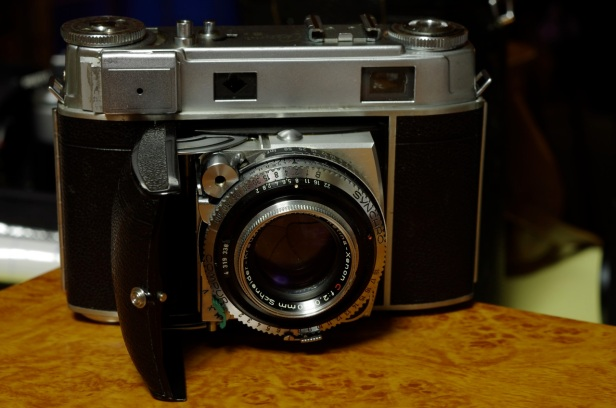 Kodak Retina IIIc, 1954-57, though based on characteristics it seems to be a 1955-56 f2 50mm Schneider Kreuznach Xenon lens (retinarescue.com/retina3cchanges.html). Serial #: 535939 Lens #: 4319338 Aperture settings above shutter, change made in May/June 1955 Has the more robust aperture clip, changed with aperture settings, May/June 1955 Does *not* have film release guard, changed in March 1956 ASA setting 5-320, it was expanded to 650 in March 1956 Has the wider exposure meter lid, changed in May 1956 Range finder ring in feet.